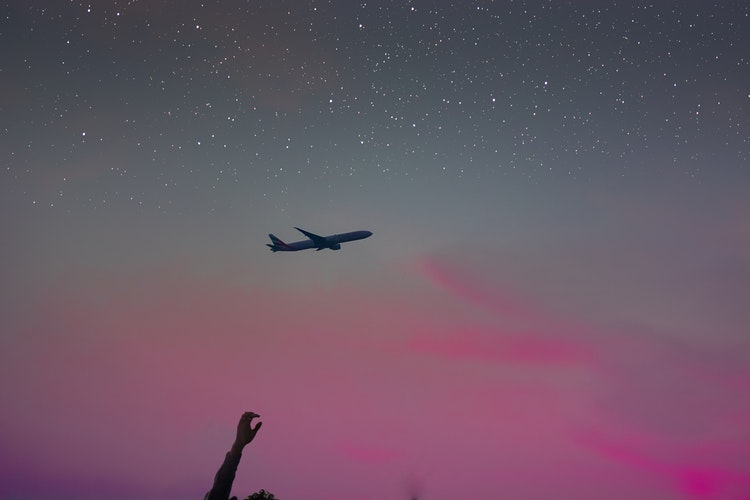 How a Poop on a Plane Helped Me Trust the Universe